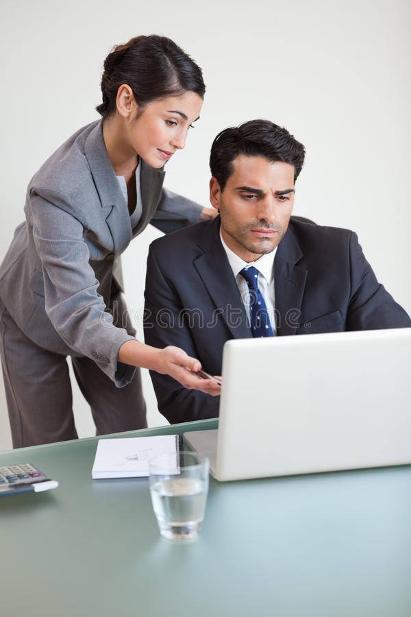 Download Portrait Of A Good Looking Business Team Working With A Notebook Royalty Free Stock Photo - Image: 22236455