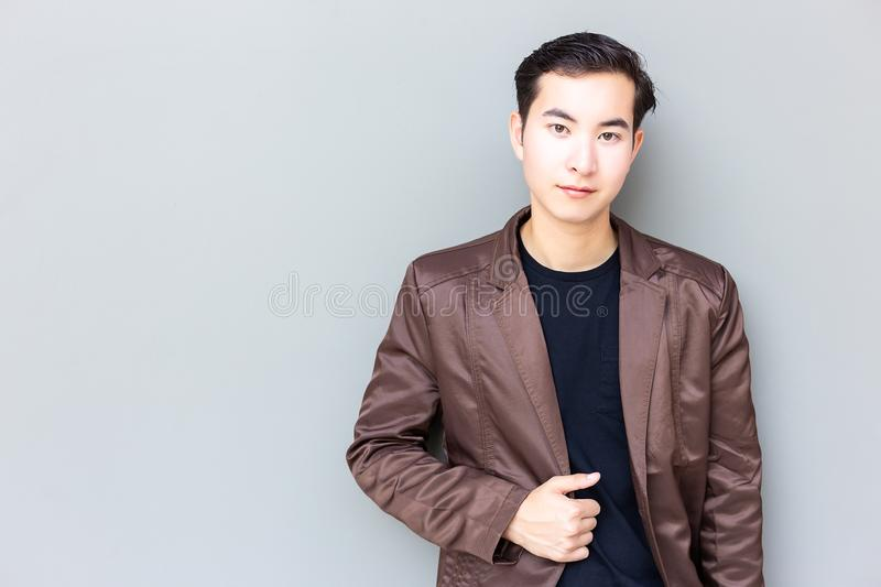 Portrait good looking man. Attractive handsome man look confident. Charming handsome young businessman get successful of his. Business. Cool guy wear leather royalty free stock photos