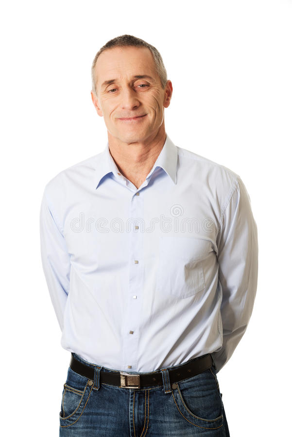 Portrait good looking man holding arms behind him royalty free stock photo