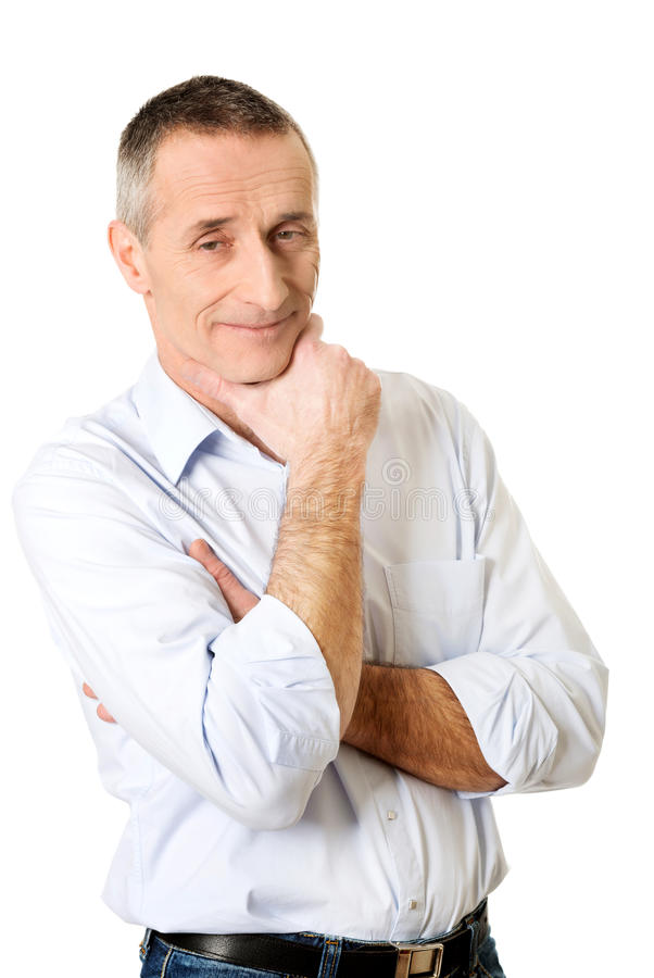 Portrait of a good looking man touching chin stock image