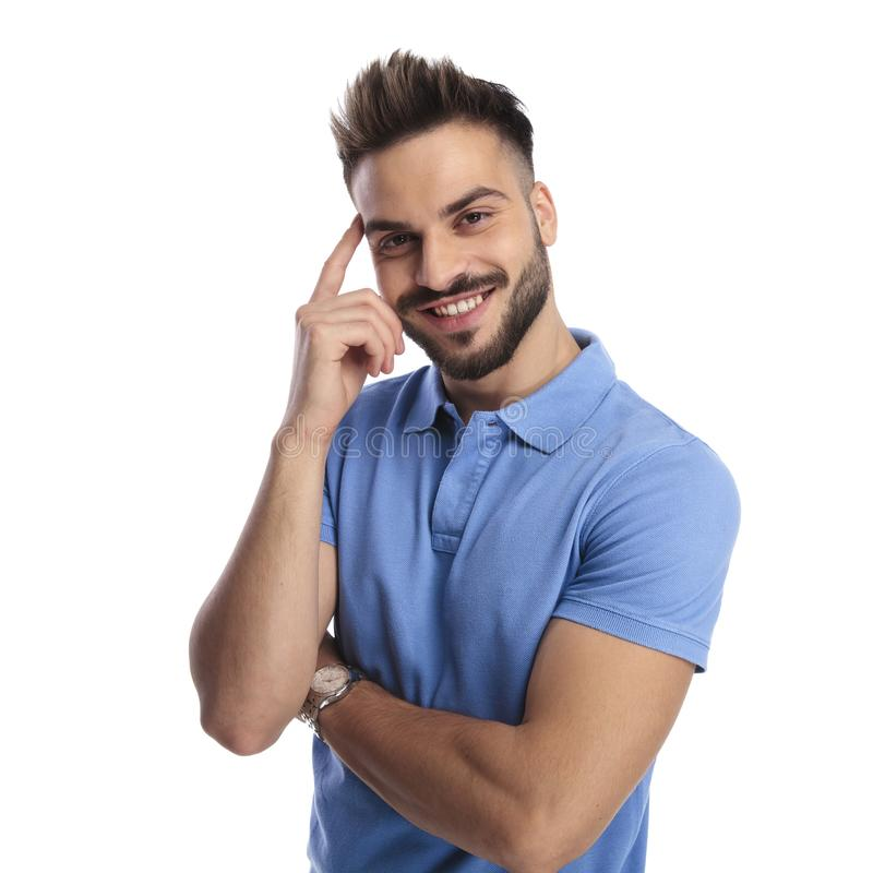 Portrait of a good-looking, well-dressed man wearing a blue polo. Portrait of a ygood-looking, well-dressed man wearing a blue polo holding his hands crossed stock images
