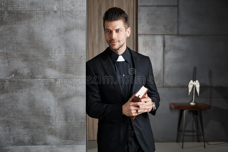Portrait of good-looking young catholic priest stock photo