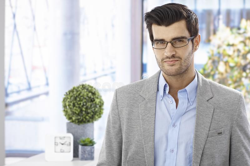 Portrait of goodlooking businessman. Portrait of goodlooking young businessman in glasses, looking at camera royalty free stock images