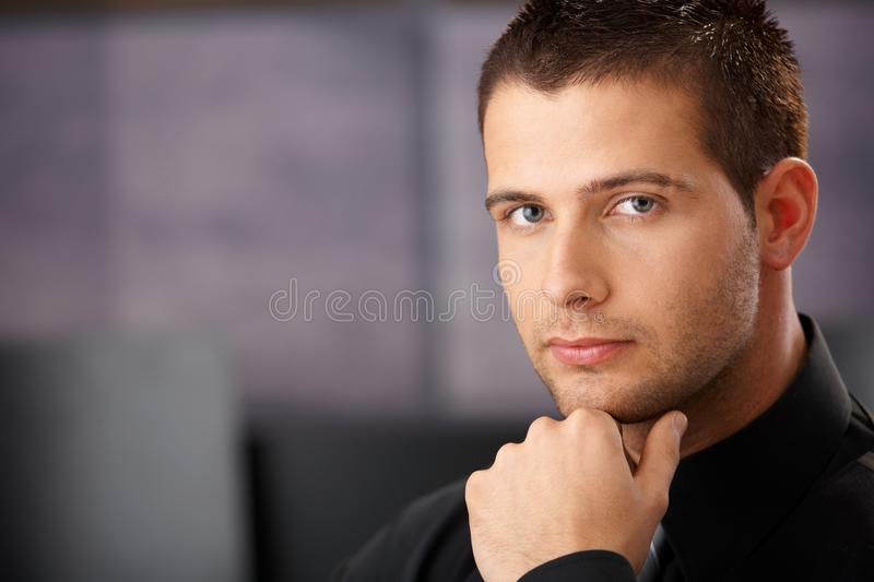 Portrait of goodlooking young businessman. Thinking stock photos