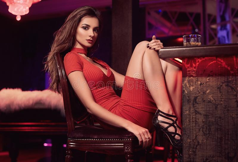 Download Gorgeous Beauty Young Brunette Woman In Red Dress With Glass Of Stock Image - Image of burn, fashion: 111634615