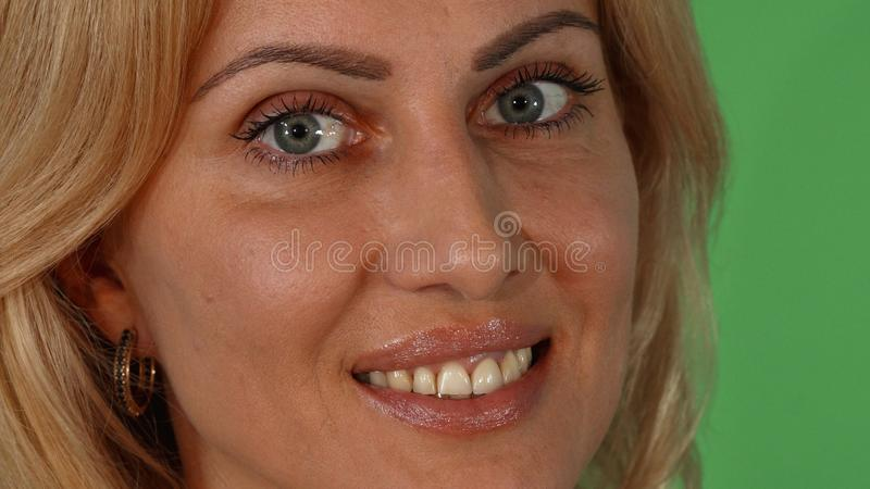 Portrait of a gorgeous blonde woman smiling to the camera stock photography