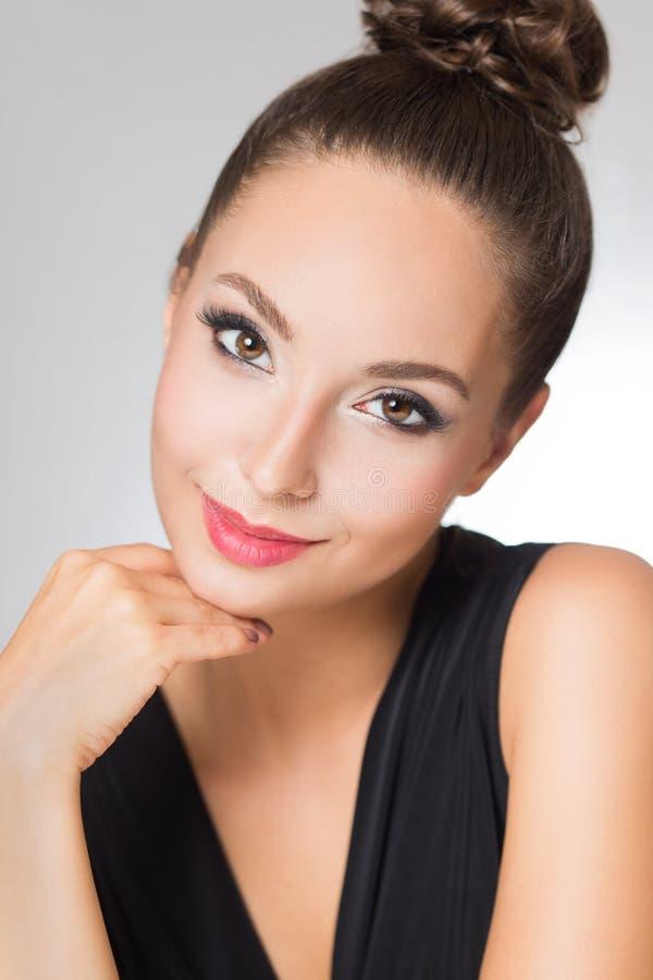 Brunette in elegant makeup royalty free stock photography