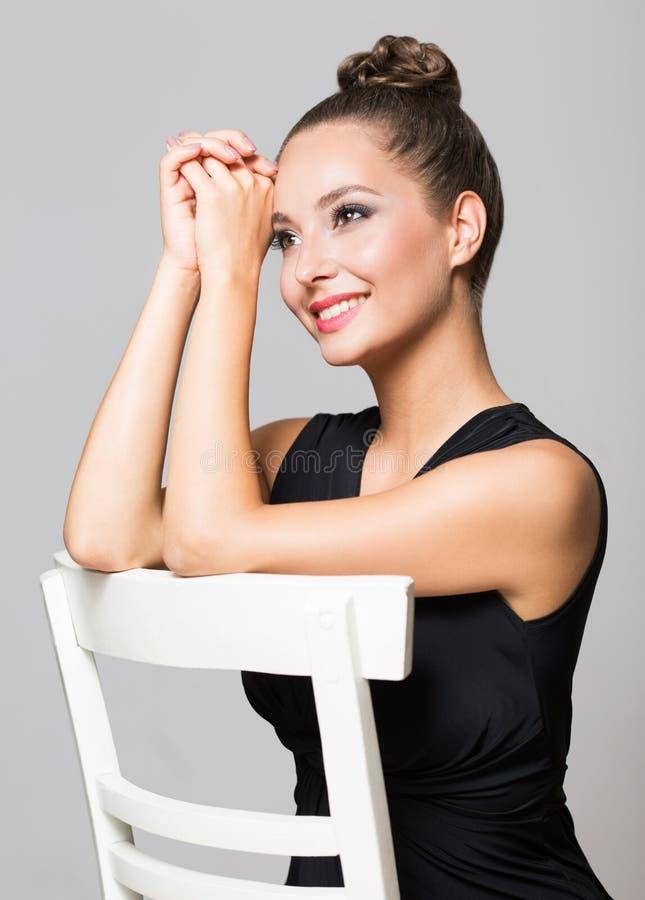 Brunette in elegant makeup stock photos