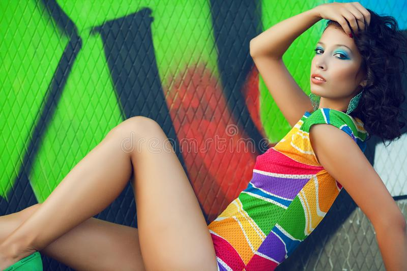 Portrait of gorgeous fashion model with arty make-up of green, b royalty free stock photos