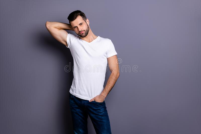 Portrait of gorgeous nice charming pretty man millennial he his good-looking touch head neck palm hand wear fashionable. Portrait of gorgeous nice charming royalty free stock image