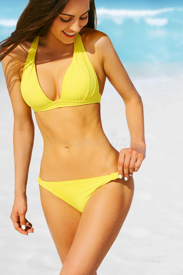 Portrait of gorgeous  woman with perfect body in bikini  on the beach stock photo