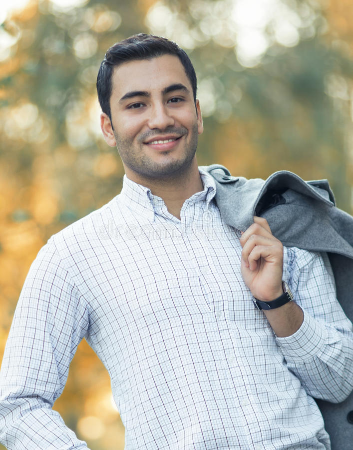 Portrait of gorgeous young attractive man. Portrait of gorgeous young smile man. Outdoor - outside. Happy turkish guy royalty free stock photography