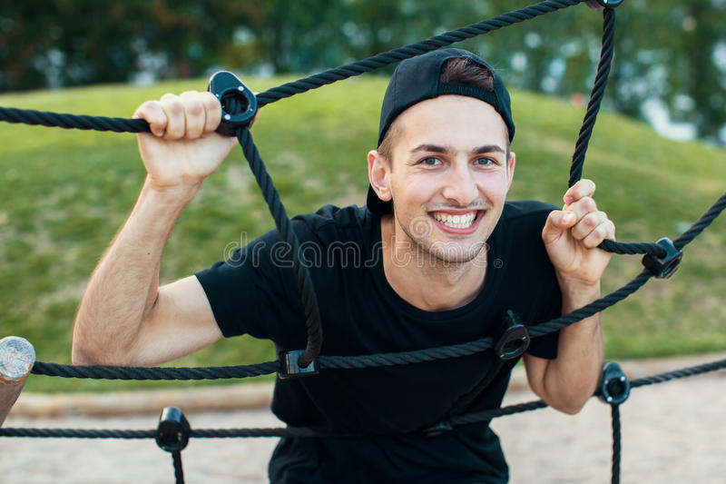 Portrait of a gorgeous young fun guy outdoors. Student. royalty free stock photo