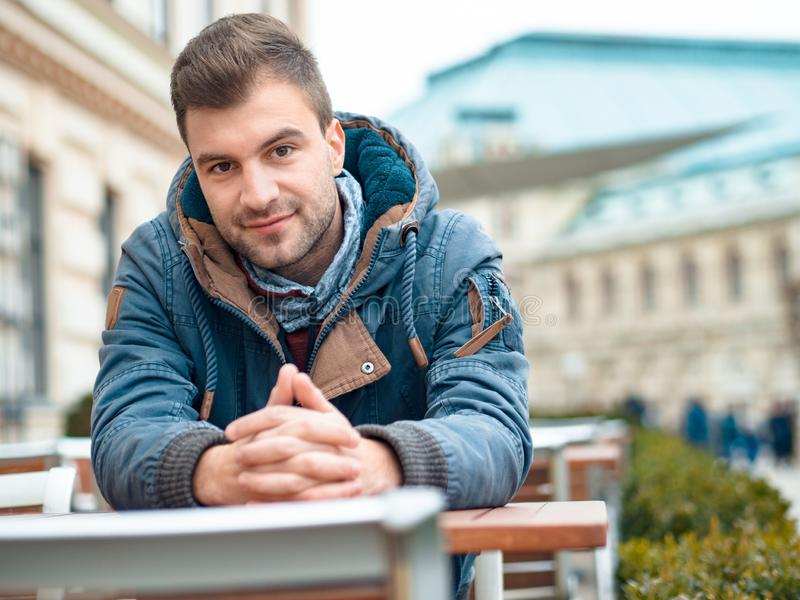 Portrait of gorgeous young man. Handsome guy looking at camera. Outdoor, outside royalty free stock image