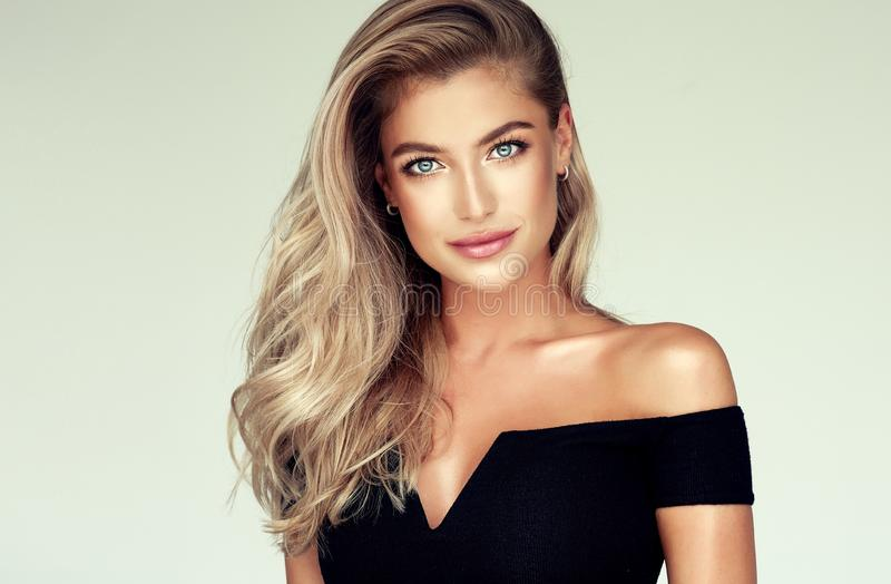 Portrait of gorgeous young woman with elegant make up and perfect golden hairstyle. stock photos