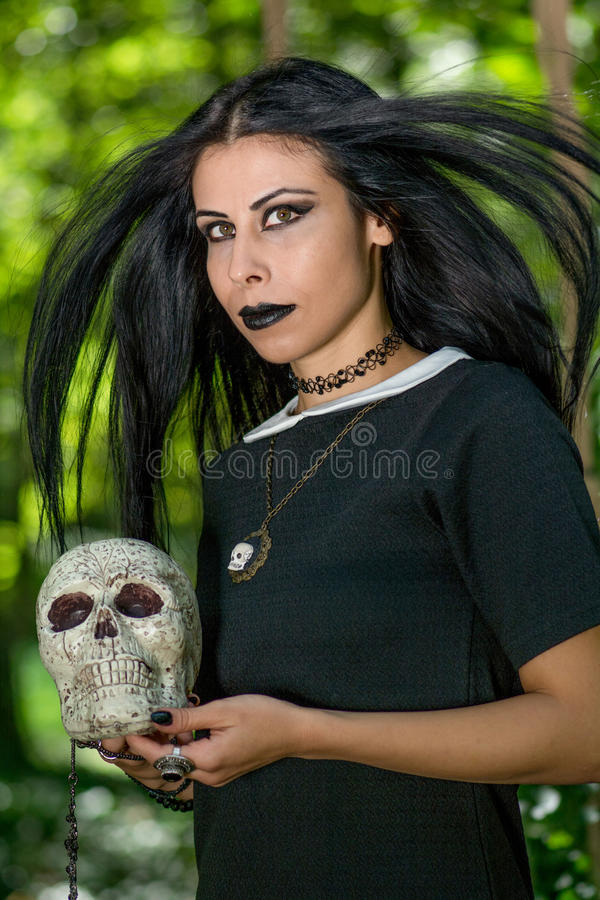 Portrait of Gothic Dark Princess. Holding skull stock photo