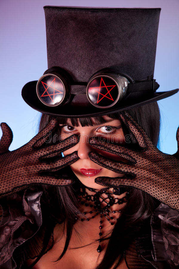 Portrait of gothic girl wearing tophat stock photography