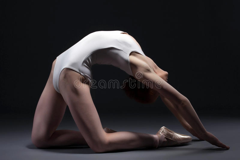 Portrait of graceful ballerina posing in studio royalty free stock photo