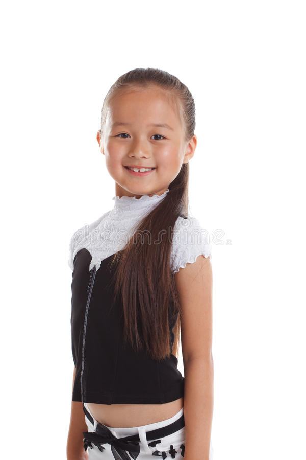 Portrait of graceful little girl smiling in studio royalty free stock photo