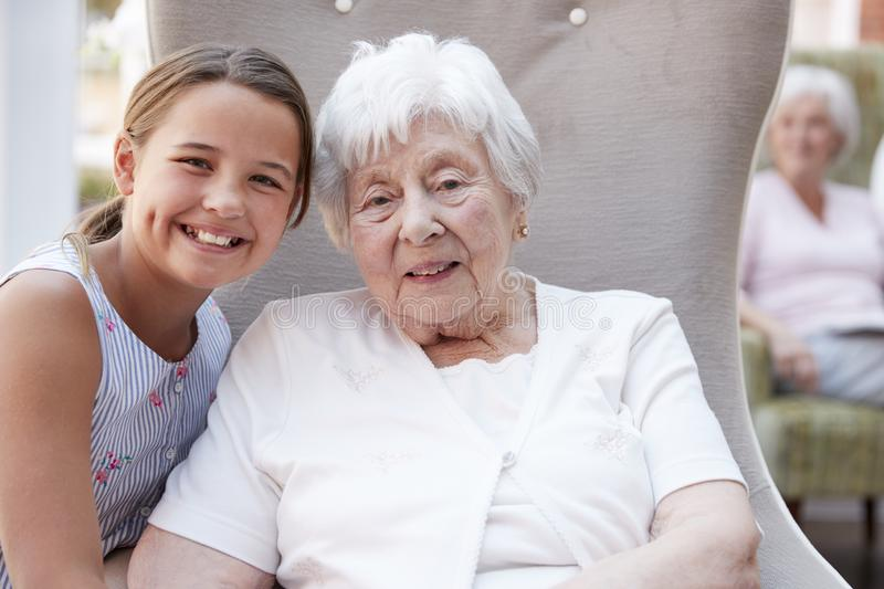 Portrait Of Granddaughter Visiting Grandmother In Retirement Home stock photo