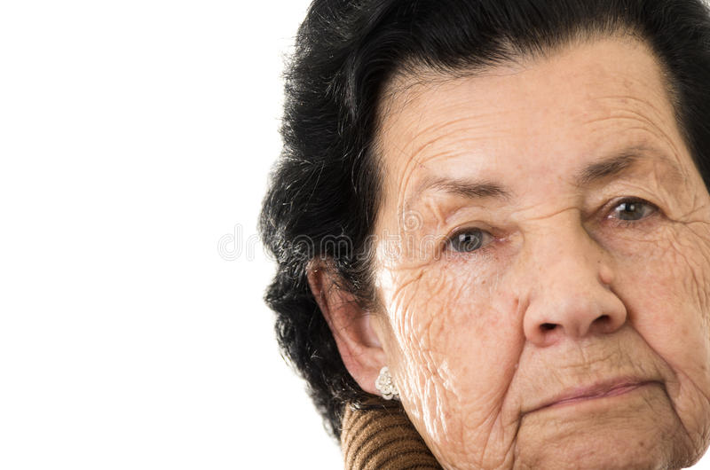 Portrait of grandmother looking nostalgic at royalty free stock photo
