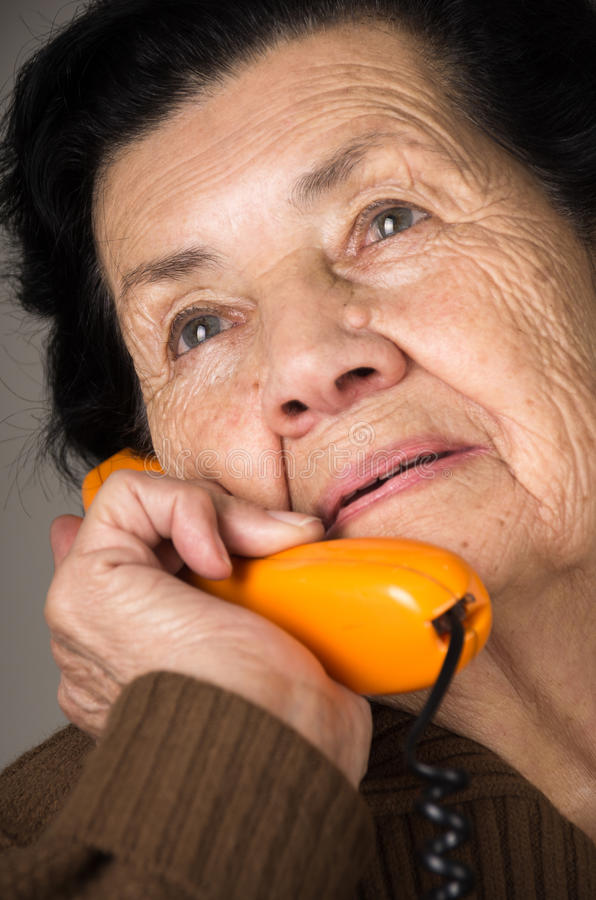 Portrait of grandmother old woman talking on the. Closeup portrait of grandmother old woman talking on the phone royalty free stock image
