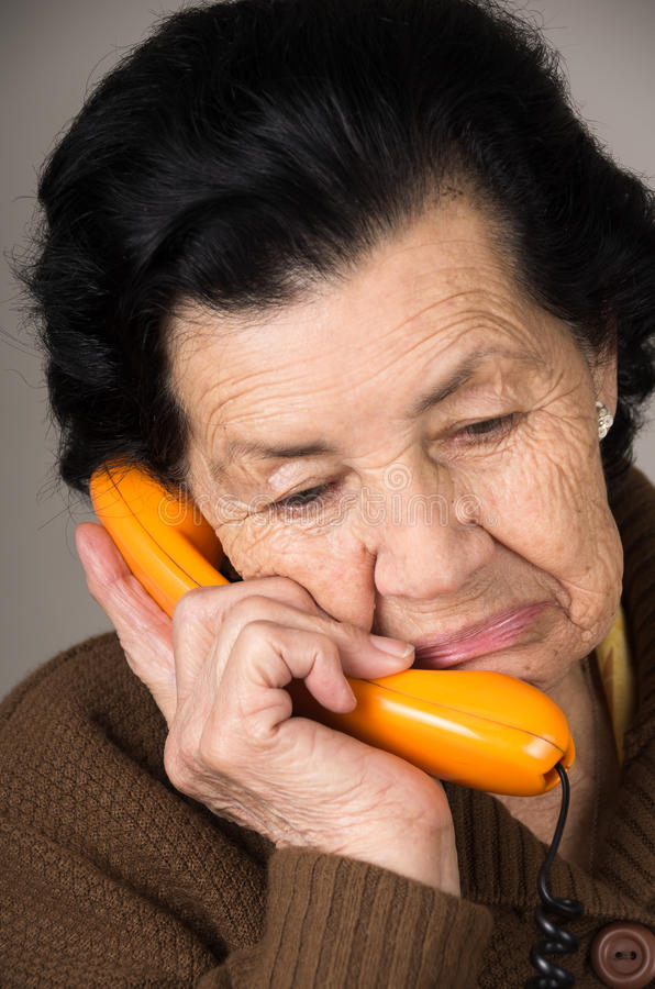Portrait of grandmother old woman talking on the. Closeup portrait of sad grandmother old woman talking on the phone stock photos