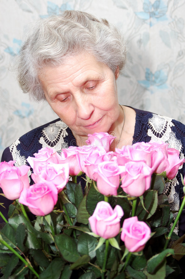 Download Portrait Of Granny Behind Bouquet Of Pink Rose Stock Image - Image: 4645873