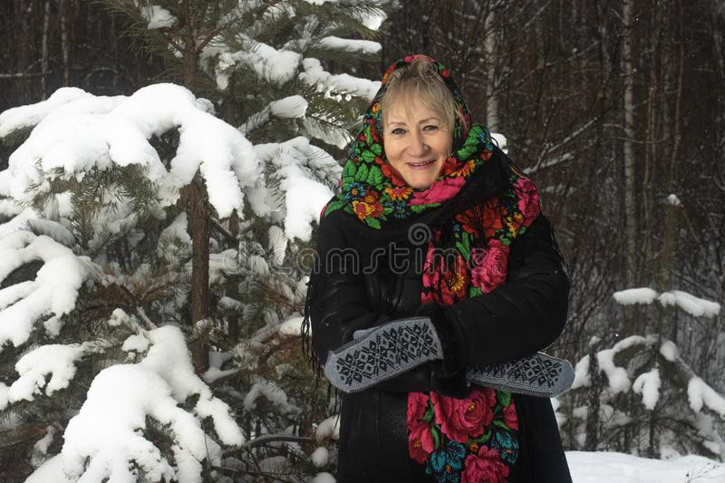 Portrait granny in flower print shawl winter outdoors stock images