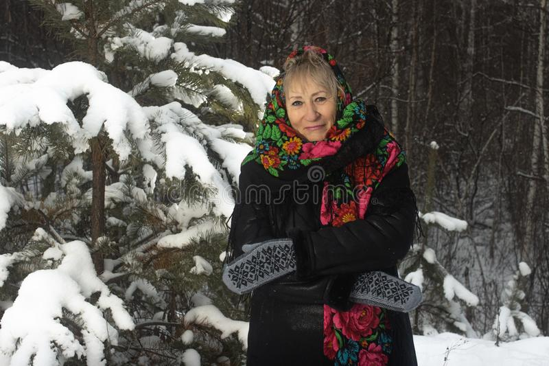 Portrait granny in flower print shawl winter outdoors royalty free stock photo