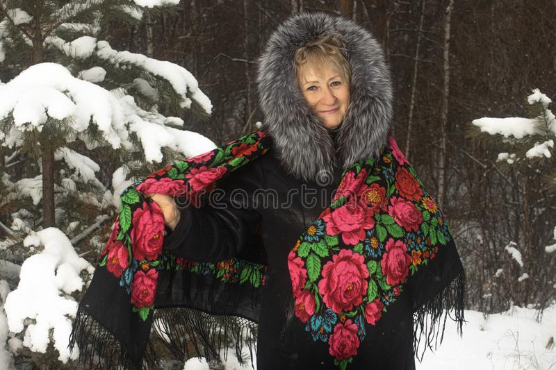 Portrait granny in flower print shawl winter outdoors royalty free stock image