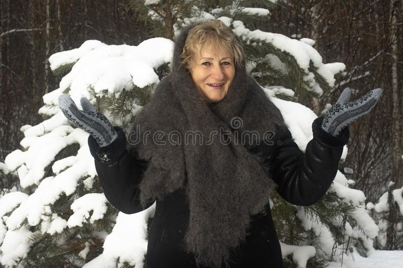 Portrait granny in natural wool shawl winter outdoors royalty free stock photo