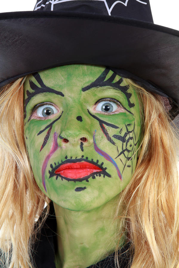 Portrait of green Halloween witch in closeup royalty free stock photo