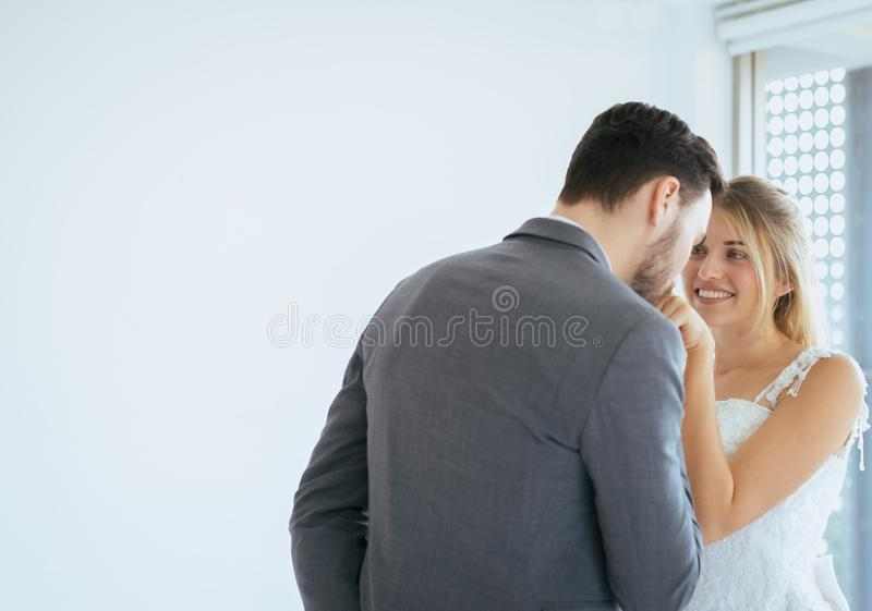 Portrait of groom with bride romantic couple is kissing and hugging together on white background,Happy and smiling in engagement d royalty free stock photography