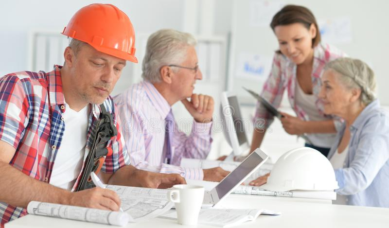 Portrait of group of business people, architects working stock photo