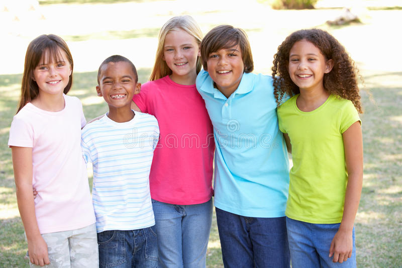Portrait Of Group Of Children Playing In Park stock images