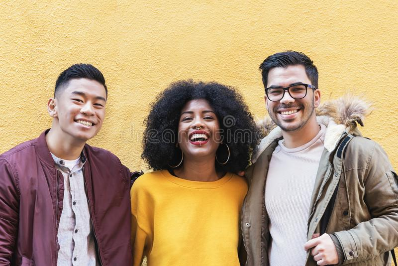Portrait of group of friends looking the camera in the street. Friendship concept stock images