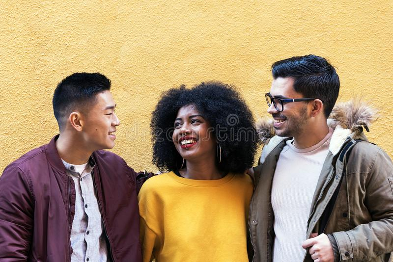Portrait of group of friends looking the camera in the street stock photo
