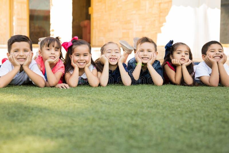 Group of happy preschool students stock photography