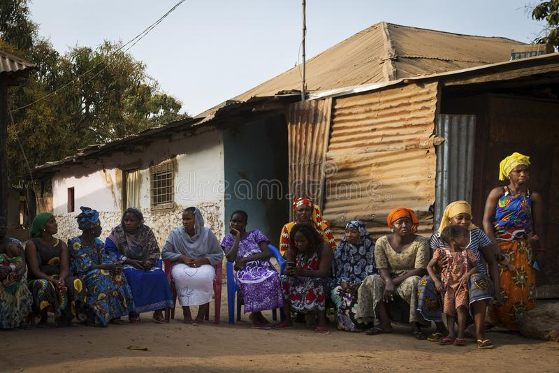 Portrait of a group of women at a community reunion in the Bissaque neighborhood in the city of Bissau. Bissau, Republic of Guinea-Bissau - January 29, 2018 stock photos
