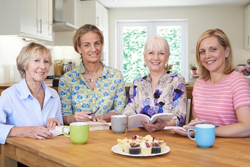 Portrait of Group Of Women Meeting For Book Group. Portrait of Mature Group Of Women Meeting For Book Group royalty free stock photography