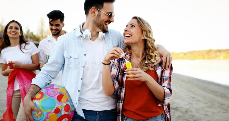 Portrait of group of young friends having a party royalty free stock image