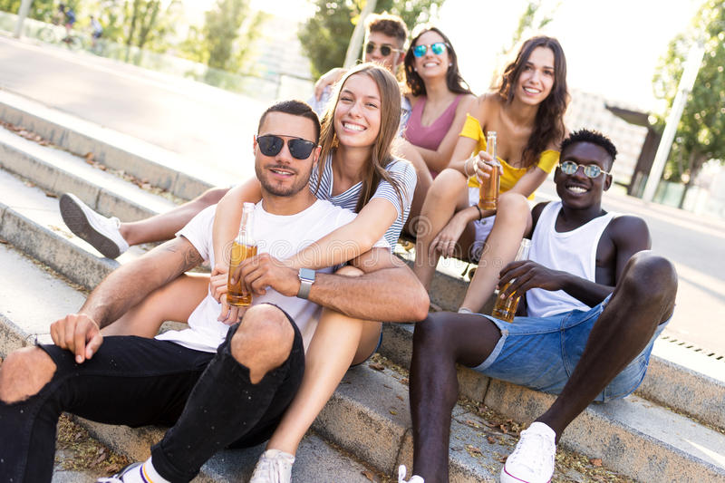 Group of young hipster friends looking at camera in an urban area. Portrait of group of young hipster friends looking at camera in an urban area royalty free stock image