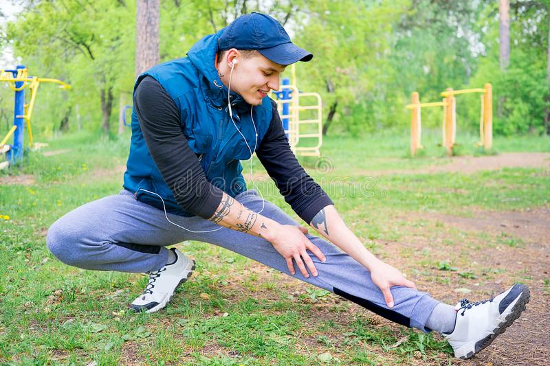 Guy working out outside. A portrait of a guy working out outside royalty free stock photos