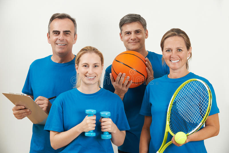 Portrait Of Gym Staff Against White Background royalty free stock photos