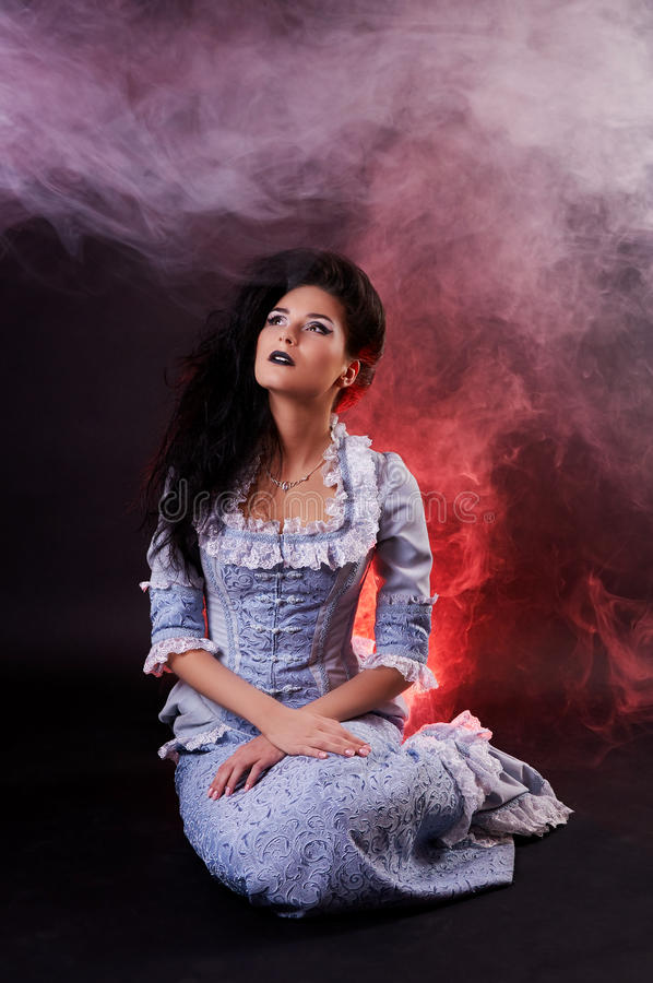 Portrait of halloween vampire woman aristocrat with stage makeup stock photography