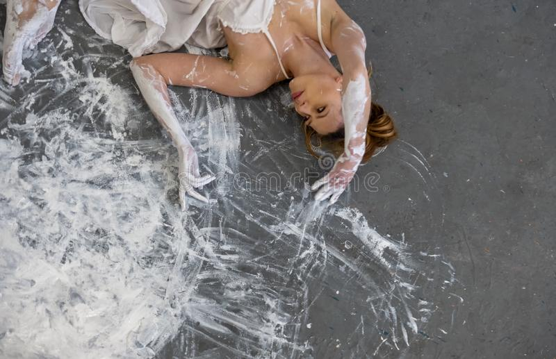 Portrait, hands and torso of a woman in gray, white, color, painted, dancing on the floor, elegantly decorative, in color. stock photography