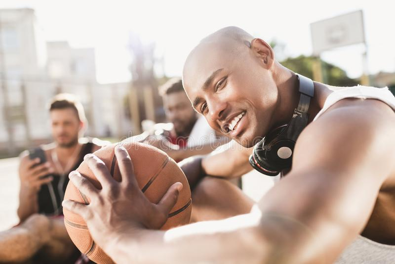 portrait of handsome african american basketball player holding ball stock image