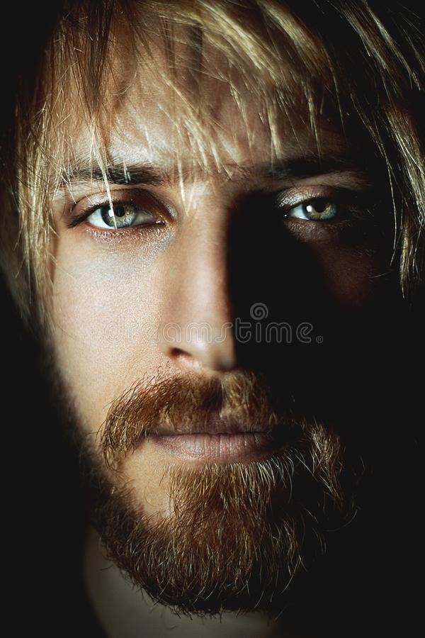 Portrait of Handsome attractive blue eyed guy. Beautiful man stock photo