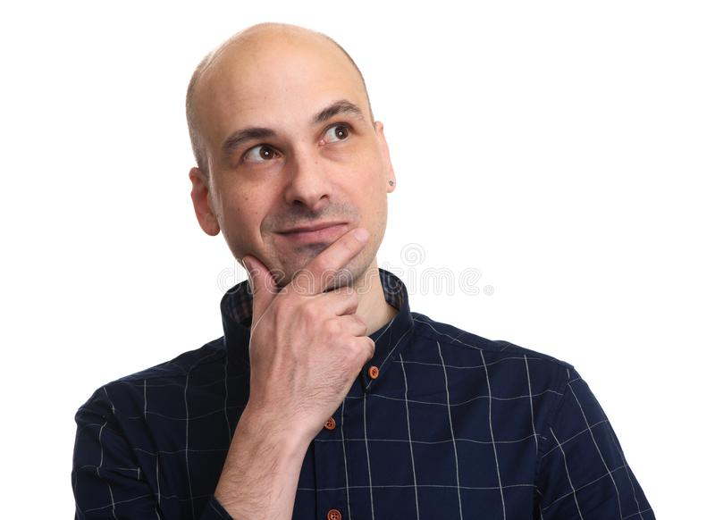 Portrait of a handsome bald man thinking royalty free stock photo